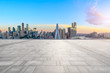 Empty square floor and modern city skyline in chongqing at sunrise,China.