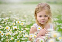 Cute Little Girl In Big Camomi...