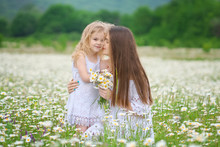 Happy Mother And Daughter In C...