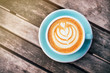 Fresh flavored coffee art on wooden background.