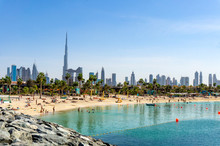 Beach In Dubai With People And Skyscapers In The Background