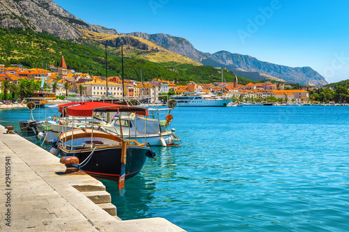 Harbor and moored touristic boats in Makarska resort, Dalmatia, Croatia
