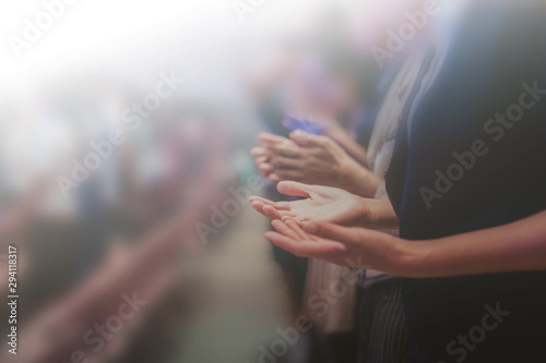 Leinwand Poster Soft focus of Christian worship with raised hand,m