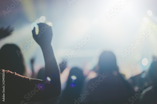 Blurred of Christian worship with raised hand,m