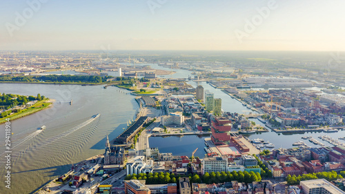 Antwerp, Belgium. Flying over the roofs of the historic city. Schelde (Esco) river. Industrial area of the city, Aerial View