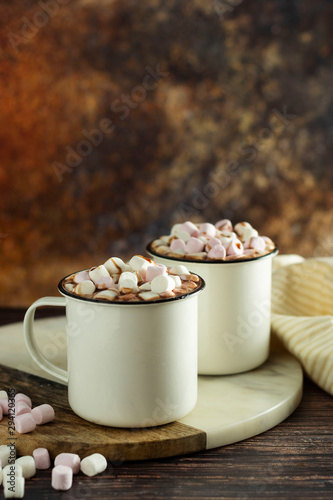 Foto auf Gartenposter Schokolade Two cups of hot chocolate, cocoa or warm drink with marshmallows on dark background