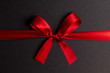 canvas print picture Red gift bow on black