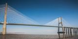 landscape of river with The Vasco da Gama Bridge in Lisbon, Portugal. This longest bridge is a famous sight in Lisbon
