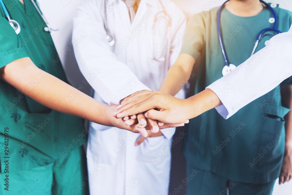Fototapeta Doctor and nurse coordinate hands. Concept Teamwork, happy doctors working together as team for motivation, success medical health care