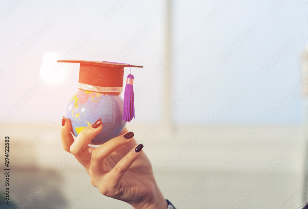 Fototapety, obrazy: Education study abroad in Global world,Back to School and Graduation cap on student hand holding Earth globe map,Success of Global business study abroad educational,congratulation Graduation Ceremony