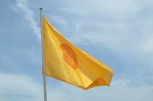 Buddhist Yellow Flag On Blue Sky
