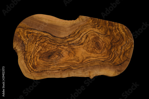 Canvas Print olive wood cutting board isolated on black