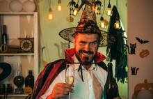 Happy Halloween Character. Man Holds A Glass And Congratulates On Halloween. Nice Guy With A Beard. Vacation Concept.