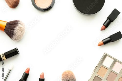Fényképezés  Flat lay image of beauty cosmetics make up with lipsticks, eye shadow palette, blush on, powder and brush