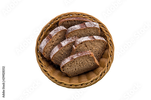 Top view of brown bread in basket isolated on white