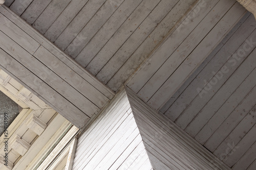 Photo Stands Old building Element of an old wood ceiling. Vintage element of building. The element of the wooden ceiling
