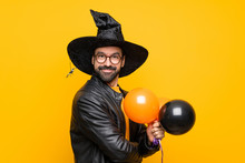 Man With Witch Hat Holding Black And Orange Air Balloons For Halloween Party With Glasses And Smiling