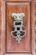 Lion Knobs On An Old Wooden Door