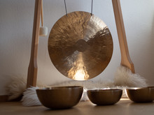 Gong In A Wooden Stand With Tibetian Singing Bowls For Sound Bath