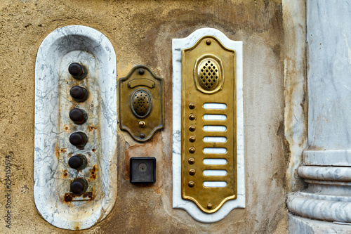 Fototapeta  Close-up of old doorbells and intercoms on the exterior wall of an ancient palac