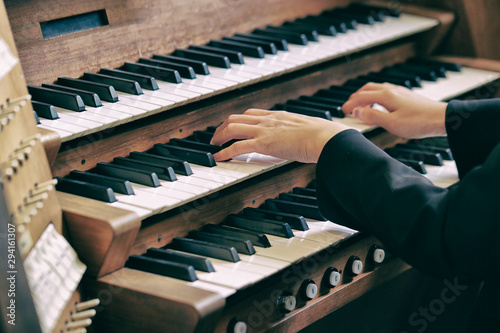 A woman playing the pipe organ  - 294161307