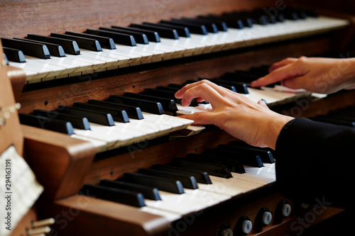A woman playing the pipe organ  - 294163191
