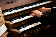 A Woman Playing The Pipe Organ