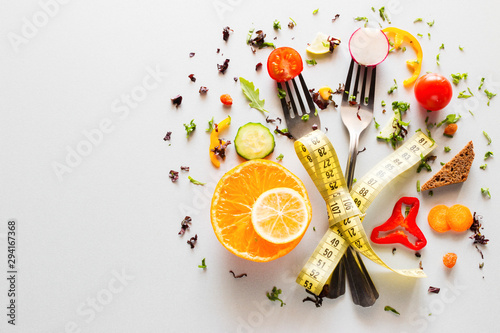 vegetables on forks with measuring tape on a white background with place for text Canvas