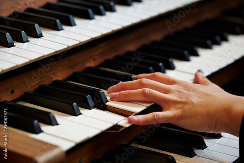 A woman playing the pipe organ  - 294167377