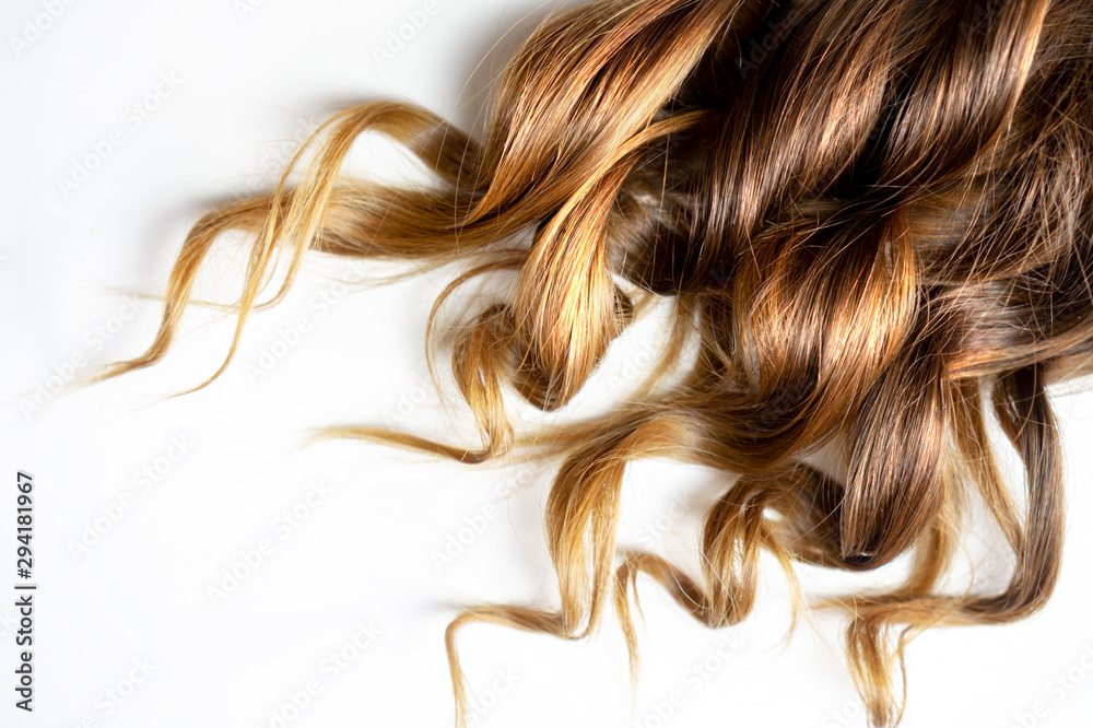 Fototapeta long brown curly hair on white isolated background
