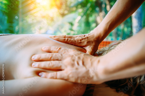 Acupressure massage in spa centre outdoor Wallpaper Mural