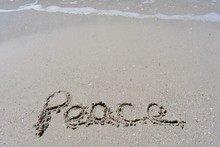 Vertical Background With Peace Written In The Sand