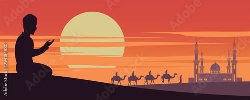Photo Muslim man pray while caravan Muslim ride camel to mosque of Dubai on sunset tim