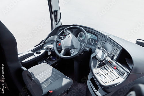 Tableau sur Toile The driver cab of a bus with a steering wheel and various devices and gadgets