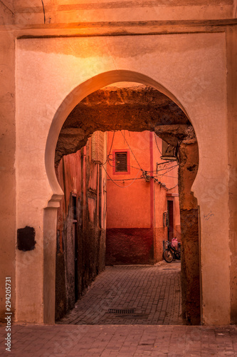Close up view of the city wall and the gate to the old medina. City wall. Marrakech, Morocco.