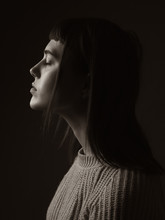 Portrait Of Young Woman. Profile. Sepia.