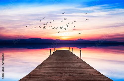 Poster Mer coucher du soleil atardecer en el lago con el reflejo del cielo
