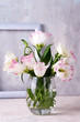canvas print picture Eustoma flowers in vase on table near stone wall, space for text. Blank for postcards