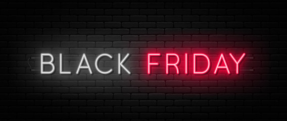Black Friday sale. Black Friday neon sign on brick wall background. Glowing white and red neon text for advertising and promotion. Banner and background, brochure and flyer design concept
