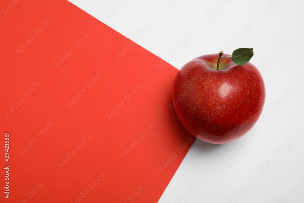 Fototapety, obrazy: Ripe juicy red apple with leaf on color background, top view. Space for text