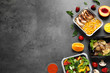 Leinwanddruck Bild - Lunchboxes on grey table, flat lay. Healthy food delivery