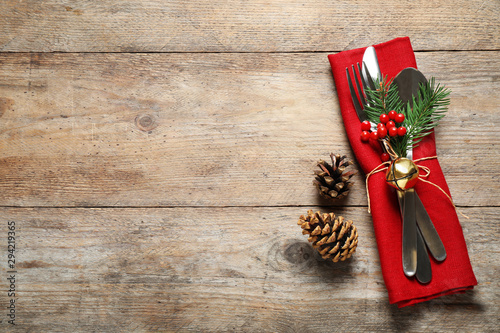 Cutlery set on wooden table, top view with space for text. Christmas celebration - 294219365
