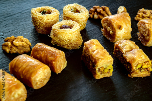 different type of arabian baklava on black background with copy space for text t Canvas Print