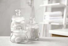 Cotton Balls, Swabs And Pads On Light Grey Table In Bathroom