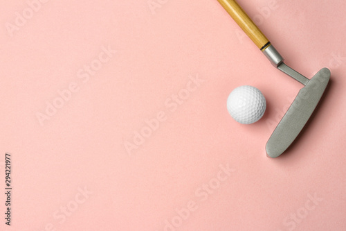 Golf ball and club on pink background, flat lay. Space for text Wallpaper Mural