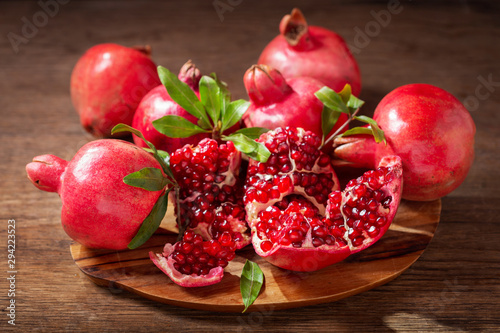fresh ripe pomegranates with leaves
