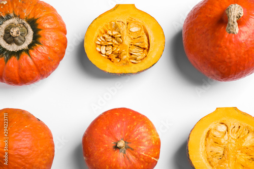 Fresh ripe pumpkins on white background, top view. Holiday decoration - 294223711