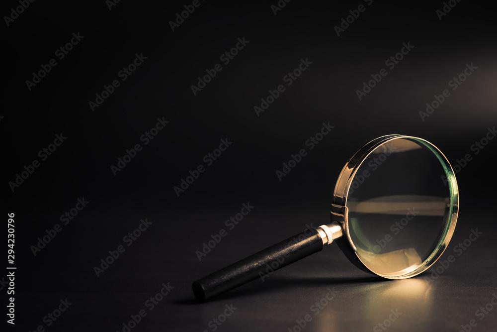 Fototapeta Magnifying Glass on Black