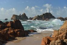 La Corbiere Point, Jersey, U.K. Lighthouse In Autumn Stormy Weather.