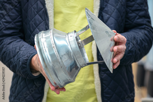 New chimney pipe cap in a worker hands. Fototapet